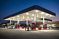 gas station with bright canopy lights