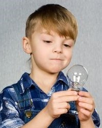 child looking at bulb